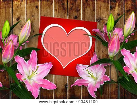 Card with heart and pink Lily flower