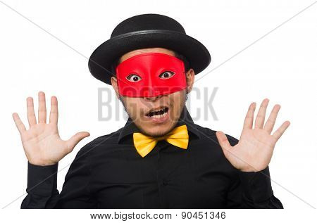 Young man in black costume and red mask isolated on white