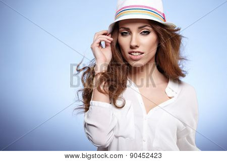 Woman with spring hat against blue  background
