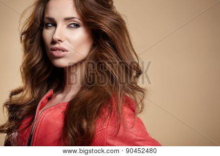 Portrait of beautiful sexy girl wearing red jacket