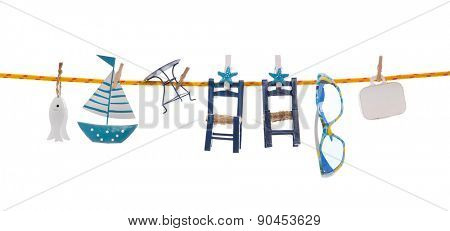 Summer holidays on the ocean. Isolated blue objects with a sail boat and luggage hanging on a clothing line.