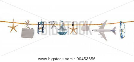 Summer concept with different utensils for traveling hanging on a line with clothing pegs.