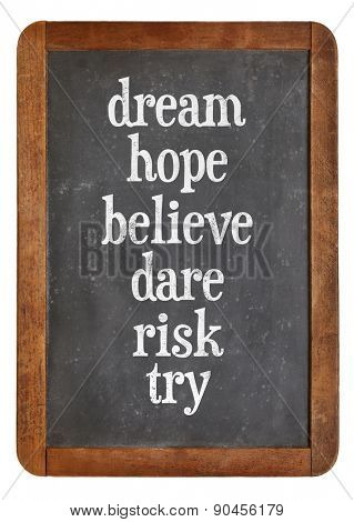 dream, hope, believe, dare, risk try - a set of motivational words n on a vintage slate blackboard