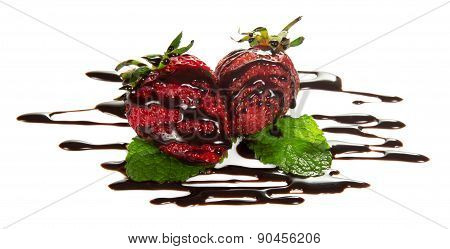 Ripe strawberries with chocolate and mint
