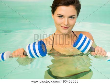 Woman on water aerobics workout