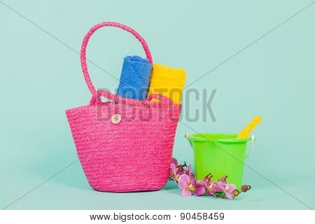 Summer vacation for family with beach bag towels and toys