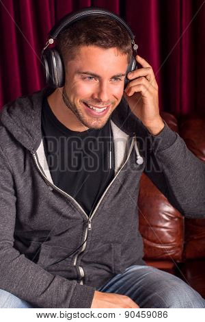 Attractive young man listening to headphones