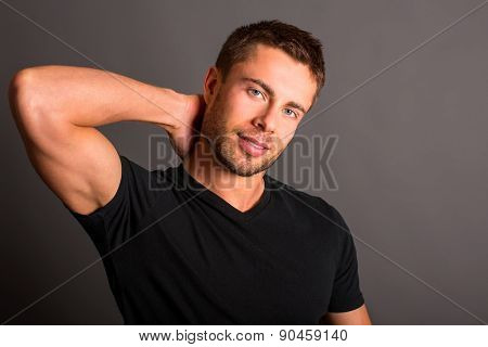 Attractive young man wearing a black t-shirt