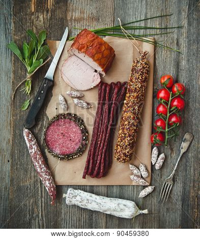 Assortment of cold meats over wooden background