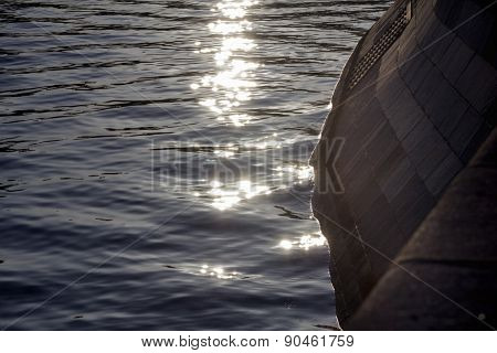 Sun's Rays On The Water Along The Promenade
