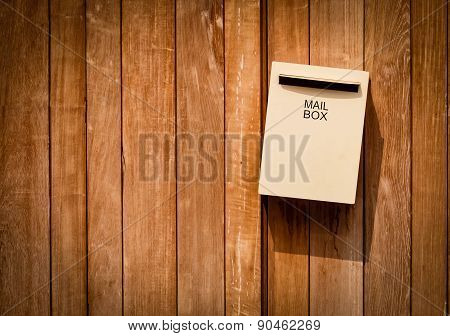 Mail Box On Brown Wood Background