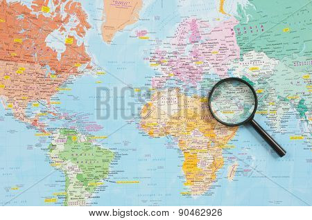 World Map And Magnifying Glass