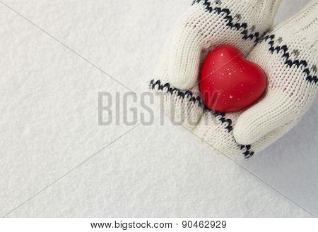 Girl's Hands Holding Red HEart