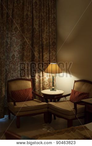 Desk Lamp And Two Chairs In The Room Of Hotel