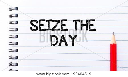 Seize The Day Text Written On Notebook Page