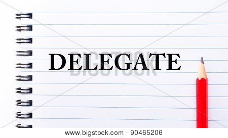 Delegate Text Written On Notebook Page