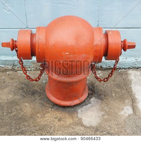 Red Fire Hydrant Beside Wall