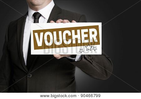 Voucher Sign Is Held By Businessman