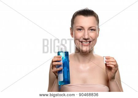 Smiling Young Woman Holding Mouthwash And A Cap