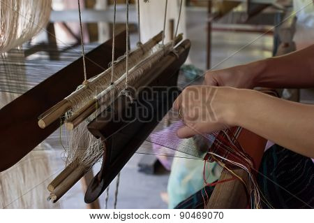 Woman Weaving Silk At Manual Loom. Laos.