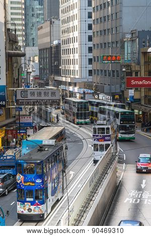 Hong Kong cityscape view with famous trams and buses
