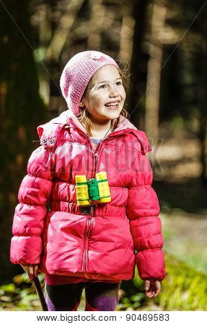 Girl With Binoculars In The Forest