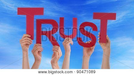 Many People Hands Holding Red Word Trust Blue Sky