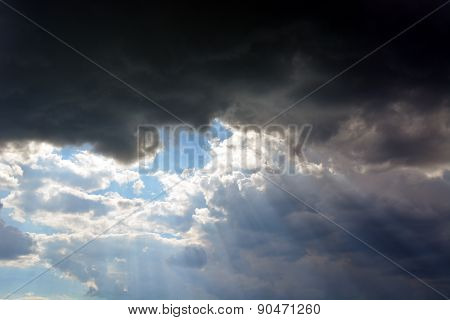 cloudy sky flare with sun rays through the clouds