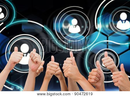 Group of hands giving thumbs up against futuristic technology interface