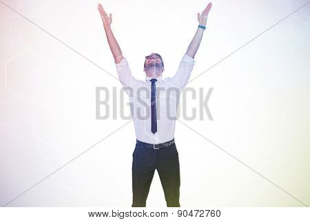 Smiling businessman cheering with his hands up against digitally generated server room with towers