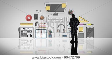 Businessman standing against grey vignette