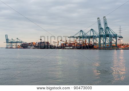 Port of Antwerp in the twilight with containers and cranes