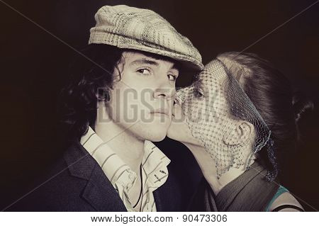 A Young Kissing Couple In Love Closeup