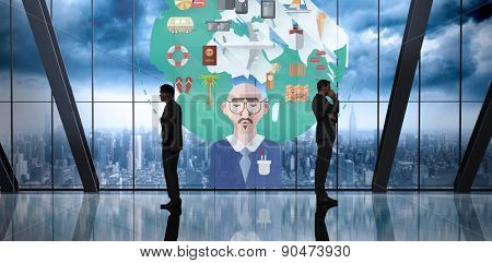 Businessman standing against room with large window looking on city