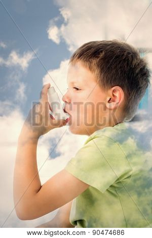 Boy using asthma inhaler in hospital against bright blue sky with clouds
