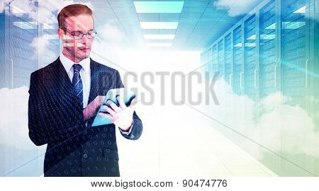 Unsmiling businessman using tablet pc against digitally generated server room with towers