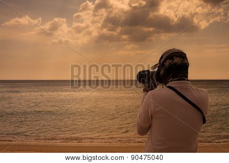 Professional Photographer Outdoor On The Beach.