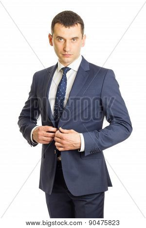 Businessman Buttoning His Suit Jacket