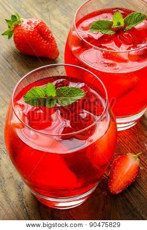 Coctail. Refreshing summer drink with Strawberry in two glasses on rustic wooden table