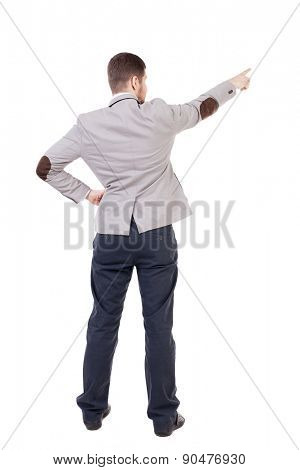 Back view of pointing business man.  office worker in a shirt and trousers powerfully indicates something Side. putting his hand on the waist, the other hand businessman showing up