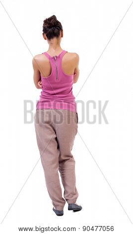 back view of standing young beautiful  woman. girl  watching. Rear view people collection.  backside view of person.  Isolated over white background. tanned girl in stylish clothes.