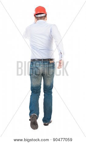 Back view of running engineer in helmet. Walking guy in motion. Rear view people collection. Backside view of person. Isolated over white background. Work rushes to the place of emergency events