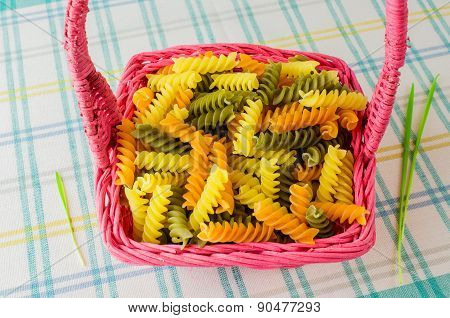 Colorful Pasta In A Wicker Basket.