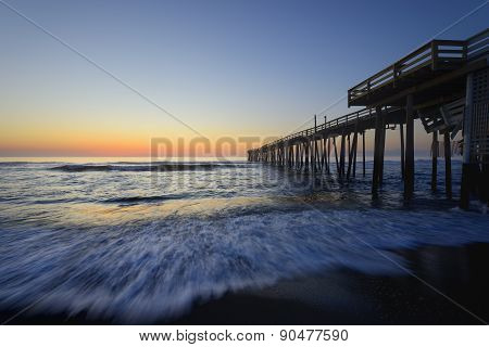 Fishing Pier and Ocean Waves at Sunrise