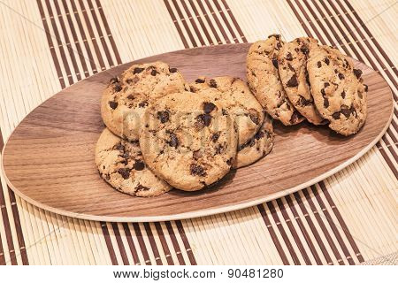 Cookies with chocolate chips on the oval wooden tray, diagonal