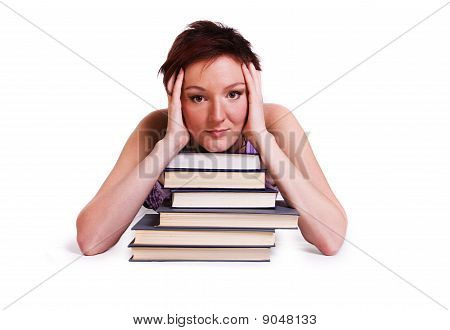 Schoolgirl with the stack of book.