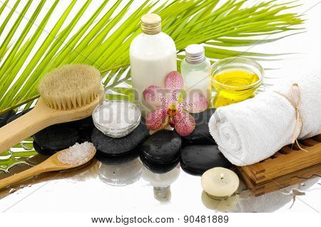 Spa Background with green palm,towel,oil,stones
