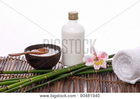 gorgeous orchid ,salt in bowl and towel ,oil ,grove on mat