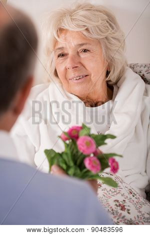 Man Giving Wife Daisy Bouquet