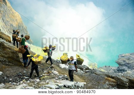Sulfur Miners In Kawah Ijen, Java, Indonesia
